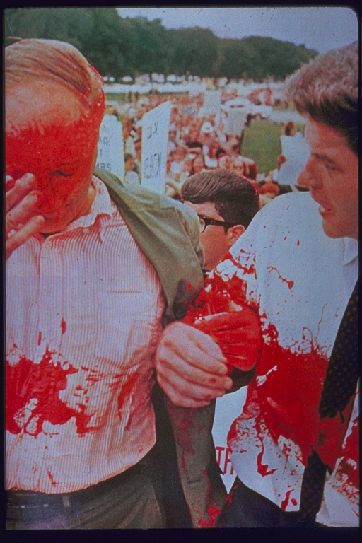 Dave Dellinger and Staughton Lynd splattered with red paint, Washington DC 1965