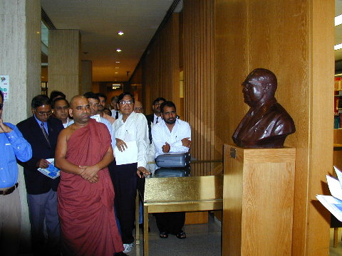Dignitaries pay homage to Dr. Bhimrao Ramji Ambedkar, visiting the bust in Columbia's Lehman Library in June 2000