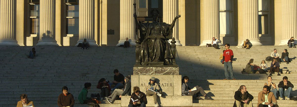 Students bask in the afternoon sun around Alma Mater on a fall day.