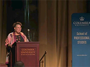 Rev. Vivian Nixon stands at the podium to deliver her Columbia Community Scholar lecture in Low Library