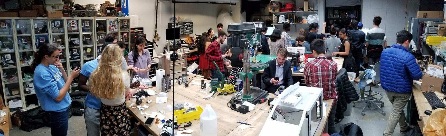 Students in a workshop surrounded by tools