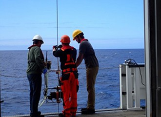 Scientists preparing pumps to sample ocean water