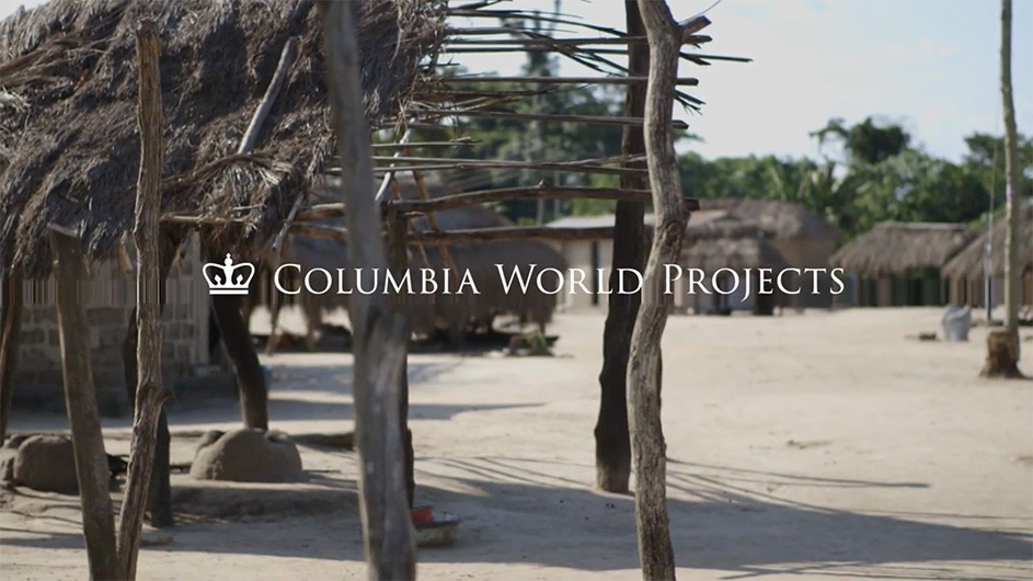 "The title ""Columbia World Projects"" overlay on a hut village in Ghana."