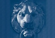 A close up of a stone lion head, the mascot of Columbia University