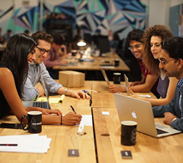 Five individuals sit around a table at Columbia Startup Lab