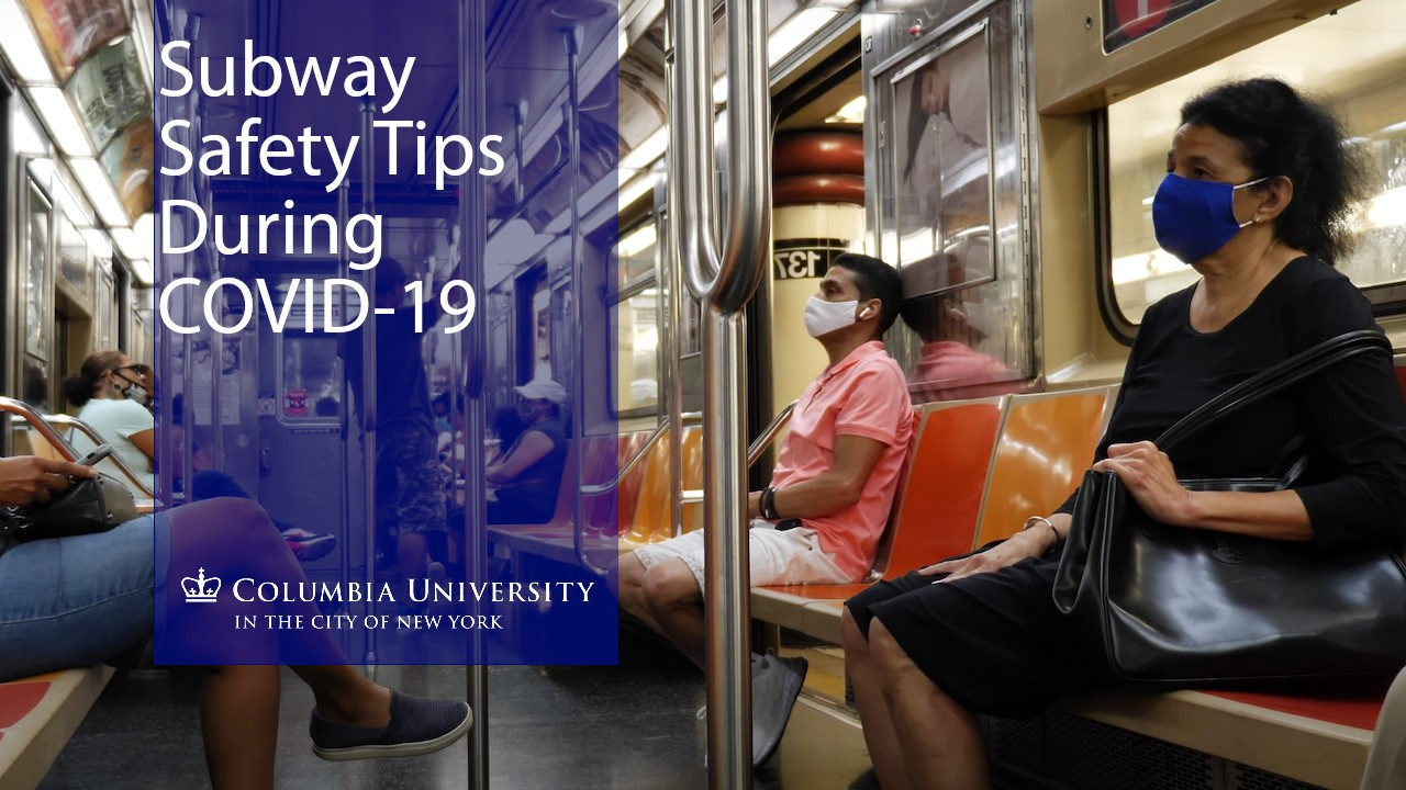 People wearing masks as they ride the NYC Subway